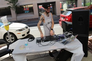 Dj Mixing it up in the street at 1 Spark